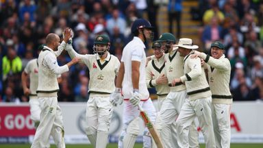 Alastair Cook of England walks after being caught by Adam Voges (3R) of Australia off the bowling of Nathan Lyon during day