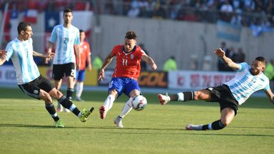 Chile's Edurado Vargas is closed down by two Argentina players