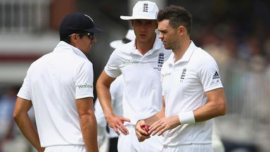 Alastair Cook speaks with Stuart Broad and James Anderson