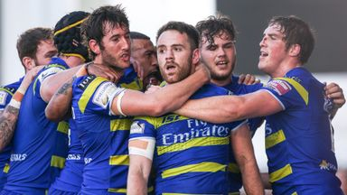 Richie Myler is mobbed by his team-mates after his wonderful try.