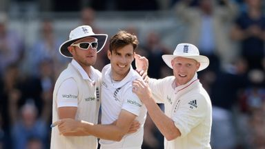 Steven Finn celebrates with team-mates Stuart Broad and Ben Stokes