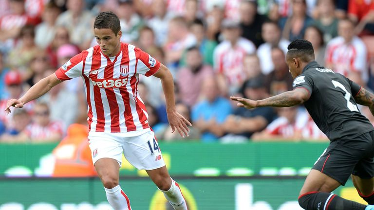 Stoke City's Ibrahim Afellay looks to take on Nathaniel Clyne of Liverpool