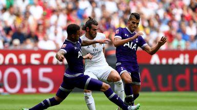 Gareth Bale (C) of Real Madrid is challenged by Kyle Walker #2 and Erik Lamela #11 of Tottenham Hotspur