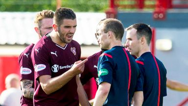 Hearts captain Alim Ozturk complains to referee Willie Collum at full-time