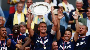 Luuk de Jong (middle) holds the Johan Cruijff Shield aloft