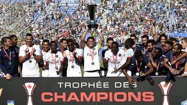Thiago Silva holds the French Trophy of Champions aloft in Montreal