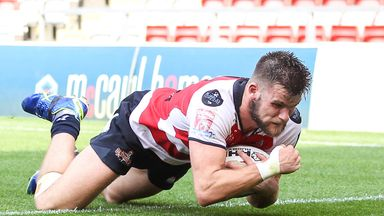 Leigh's Liam Kay scores a try against Wakefield