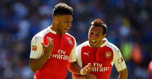 Alex Oxlade-Chamberlain: Celebrates his goal with Santi Cazorla