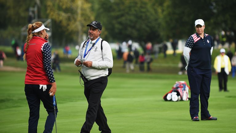 LPGA referee Dan Maselli tells Alison Lee that her putt is not conceded on the 17th green