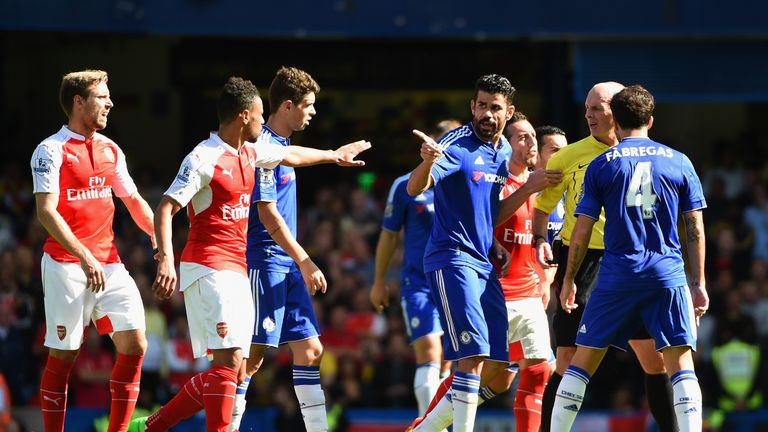 Referee Mike Dean speaks to Costa