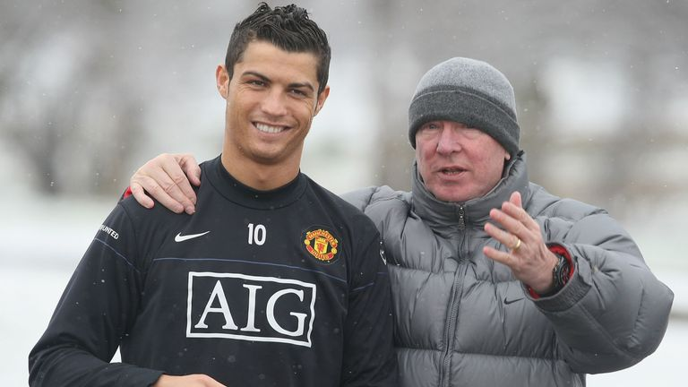 Sir Alex Ferguson (right) says the ruling created a 'free-for-all' in the game