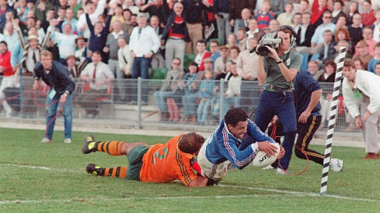 French full-back Serge Blanco dives in to score the winning try of the 1987 World Cup semi-final as Australian hooker Thomas Lawton tackles him in vain