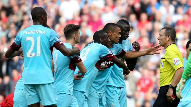West Ham players react after Mark Noble's red card at Liverpool