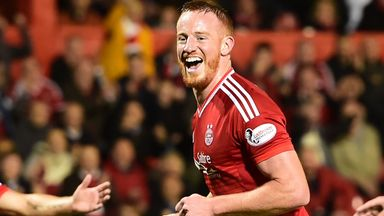 Adam Rooney was on the mark for Aberdeen who moved into second