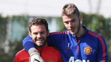 Juan Mata and David de Gea of Manchester United during a first-team training session