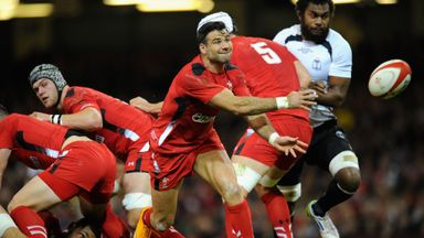 Wales scrum-half Mike Phillips passes the ball against Fiji