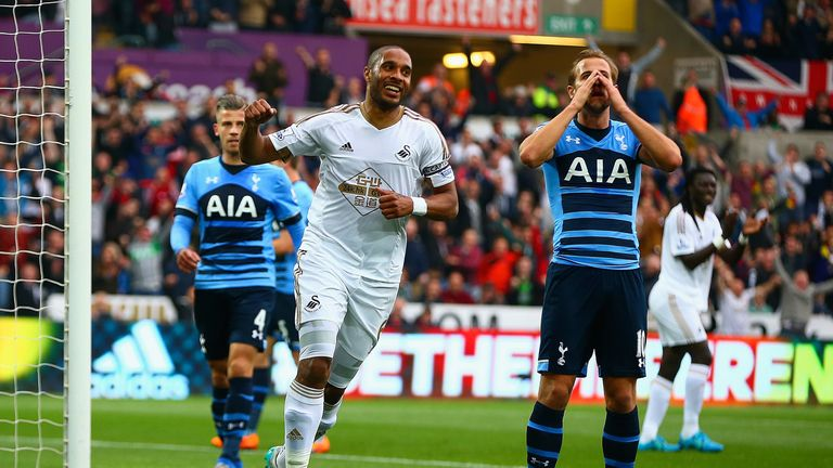 Ashley Williams of Swansea City celebrates after Harry Kane of Tottenham scores an own goal
