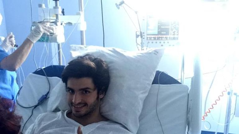 Carlos Sainz's manager posted a picture of the driver sitting up and giving the thumbs-up from hospital