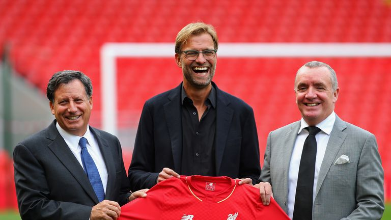 Jurgen Klopp is unveiled as the new manager of Liverpool FC as he stands alongside Tom Werner (l) the chairman and Ian Ayre (r) the chief executive