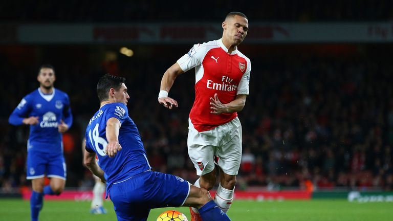 Everton's Gareth Barry fouls Kieran Gibbs of Arsenal to earn a second booking and a red card