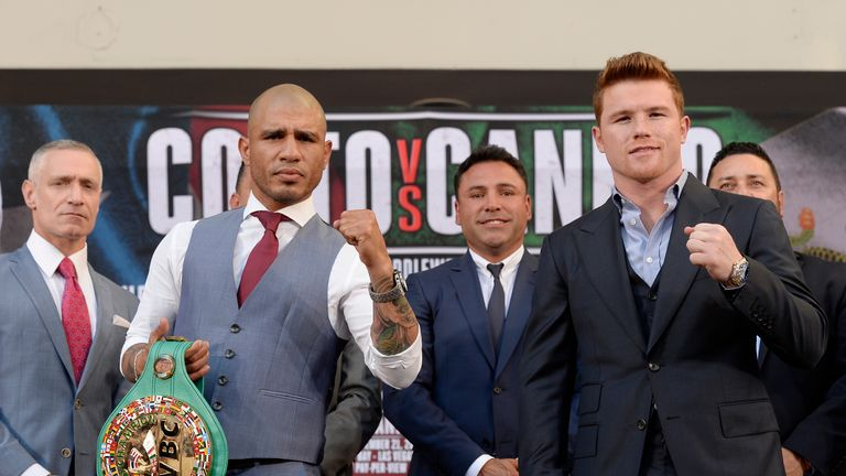 Miguel Cotto (left) defends WBC gold against Alvarez on November 28