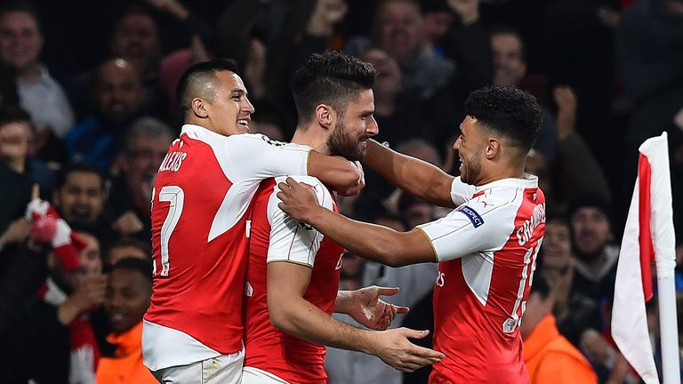 Olivier Giroud (middle) celebrates Arsenal's first goal
