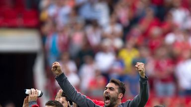 Vicente Iborra (right) celebrates Sevilla's victory over Barcelona with his team-mate Kevin Gameiro