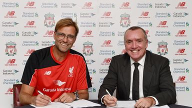 Jurgen Klopp signs his contract to manage Liverpool with chief executive Ian Ayre