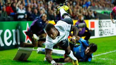 Fiji's Nemia Kenatale holds off Uruguay's Alejo Duran as he scores his side's second try