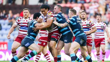 Taulima Tautai is tackled by Kylie Leuluai, Jamie Peacock and Brad Singleton during Wigan's 26-24 win over Leeds on July 9