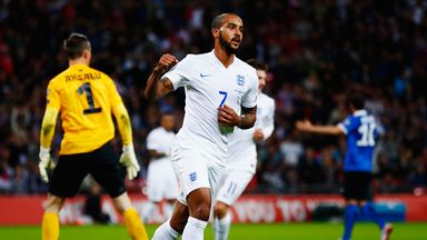 Theo Walcott of England celebrates scoring the opening goal.