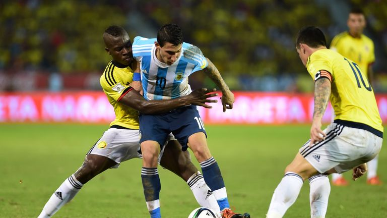 Argentina's Angel Di Maria (centre) tries to hold onto possession