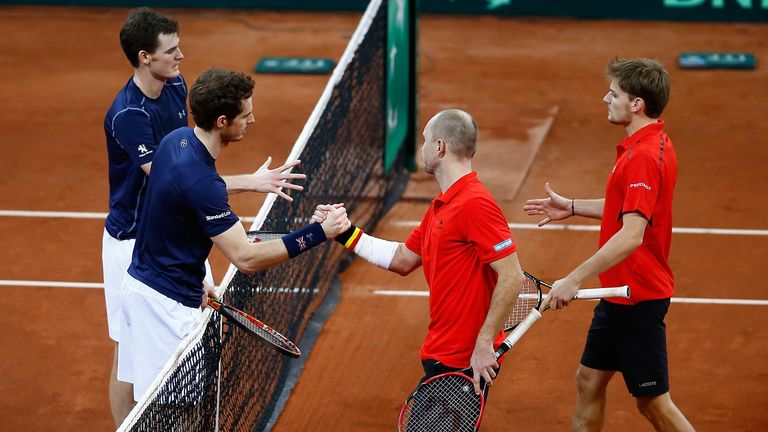 Great Britain's pair shake hands with Steve Darcis and David Goffin (far right)