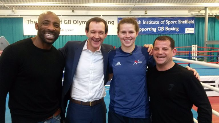 Adam Smith (centre) and Johnny Nelson (L) have boosted Savannah Marshall