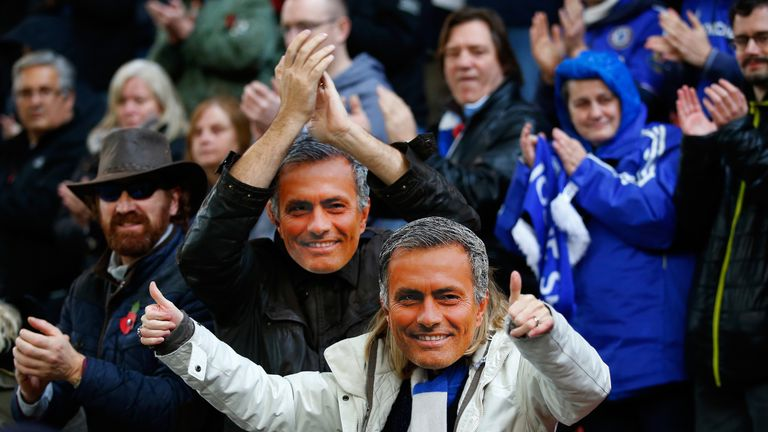 Chelsea fans arrive at Stoke sporting Jose Mourinho masks