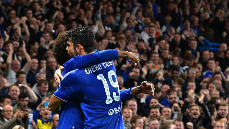 Willian celebrates with Diego Costa during a Champions League clash earlier in the seasn