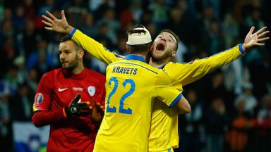 Andriy Yarmolenko celebrates his last-minute goal with Artem Kravets.