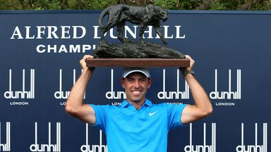 Charl Schwartzel poses with the trophy after victory at the Alfred Dunhill Championship