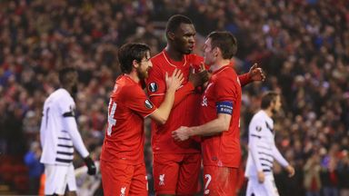 Christian Benteke of Liverpool (C) celebrates with Joe Allen (L) and James Milner (R) after scoring in the Europa League clash v Bordeaux