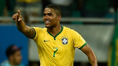 Douglas Costa celebrates after scoring Brazil's opening goal against Peru