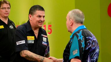 Defending champion Gary Anderson edged out Phil Taylor in the first round (Pic by Lawrence Lustig)
