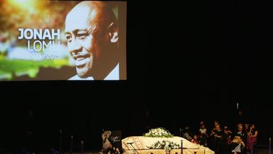 The casket containing the body of Jonah Lomu sits at the front of the Aho Faka Famili memorial in Auckland