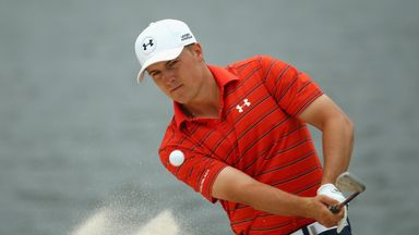 Jordan Spieth splashes out of a bunker at the fourth hole, on day three in Sydney