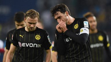 Marcel Schmelzer and Mats Hummels of Dortmund look dejected