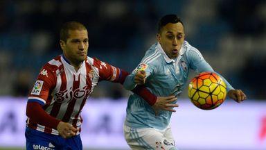 Sporting Gijon defender Alberto Lora (L) vies with Celta Vigo's Fabian Orellana.