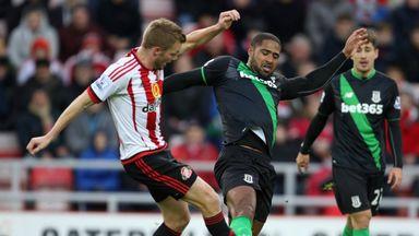Sunderland's Sebastian Larsson (left) challenges Stoke City's Glen Johnson at the Stadium of Light on Saturday