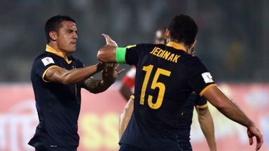 Tim Cahill of Australia celebrates with Mile Jedinak after scoring his first goal.