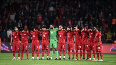Turkey's players mark the minute's silence ahead of kick-off