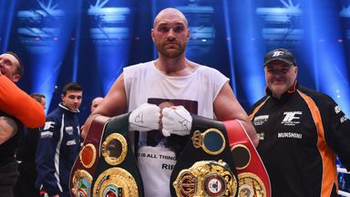 Tyson Fury celebrates with his belts after defeating Wladimir Klitschko