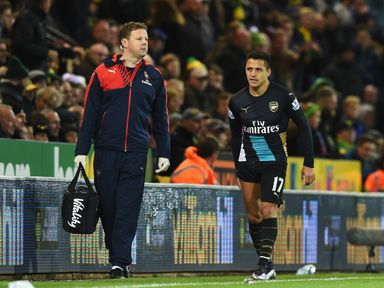 Arsenal's Alexis Sanchez leaves the pitch with a suspected hamstring injury